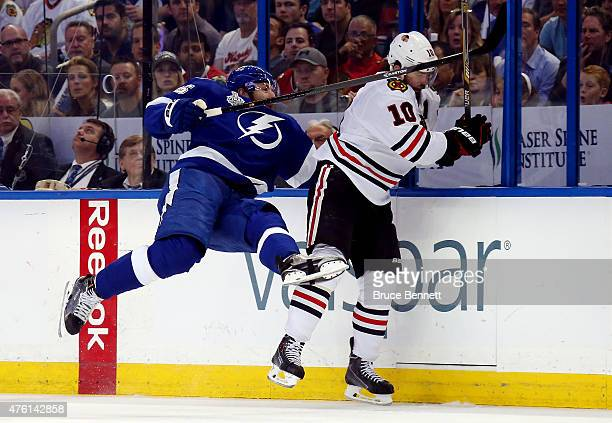 Braydon Coburn of the Tampa Bay Lightning checks Patrick Sharp of the Chicago Blackhawks during the first period in Game Two of the 2015 NHL Stanley...