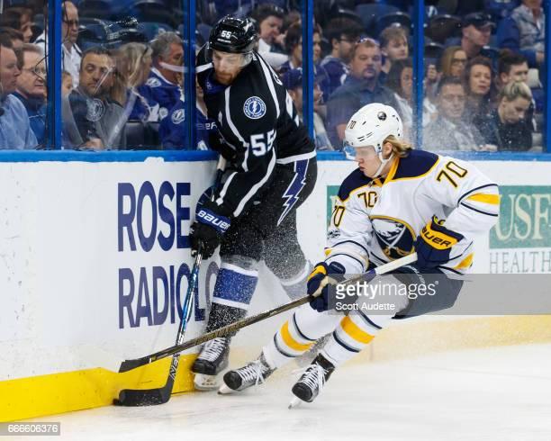 Braydon Coburn of the Tampa Bay Lightning skates against Alexander Nylander of the Buffalo Sabres during second period at Amalie Arena on April 9...