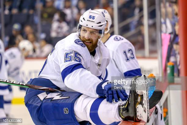 Braydon Coburn of the Tampa Bay Lightning stretches at the bench during the pregame warm up prior to NHL action against the Winnipeg Jets at the Bell...