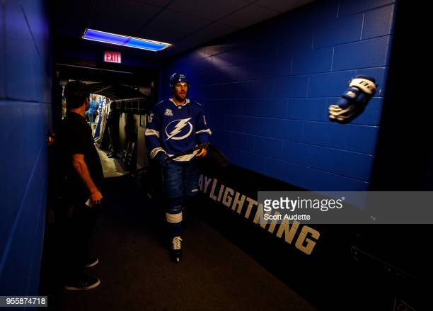 Braydon Coburn of the Tampa Bay Lightning throws his glove after coming off the ice against the Boston Bruins after pregame warm ups during Game Five...