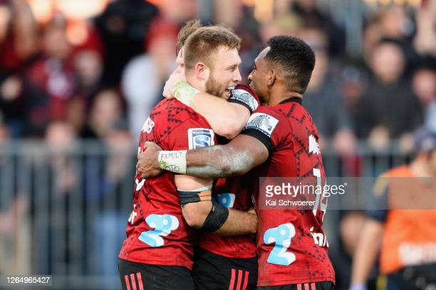 Braydon Ennor is congratulated by Sevu Reece of the Crusaders after scoring a try during the round 9 Super Rugby Aotearoa match between the Crusaders...