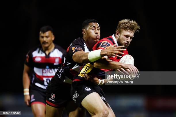Braydon Ennor of Canterbury is tackled by Nigel Ah Wong of Counties Manukau during the round nine Mitre 10 Cup match between Counties Manukau and...