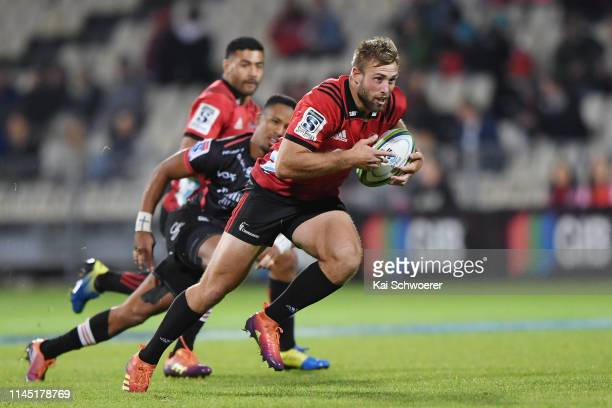Braydon Ennor of the Crusaders runs through to score a try during the round 11 Super Rugby match between the Crusaders and Lions at Christchurch...