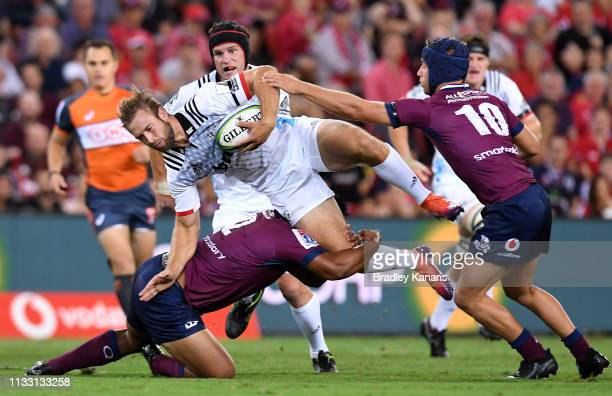 Braydon Ennor of the Crusaders takes on the defence during the round three Super Rugby match between the Reds and the Crusaders at Suncorp Stadium on...