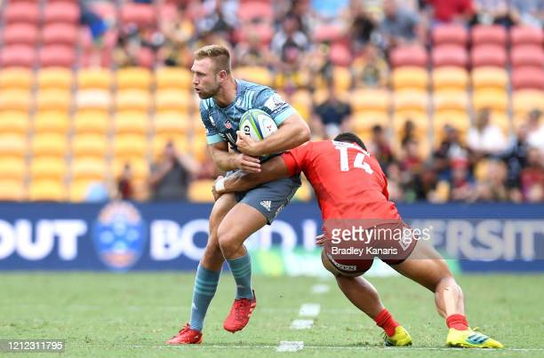 Braydon Ennor of the Crusaders takes on the defence during the round seven Super Rugby match between the Sunwolves and the Crusaders at Suncorp...