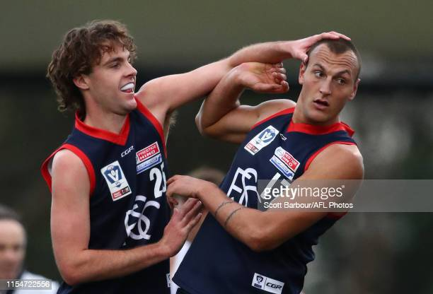 Braydon Preuss of Casey is congratulated by Austin Bradtke and his teammates after kicking a goal during the round 10 VFL match between Casey and...
