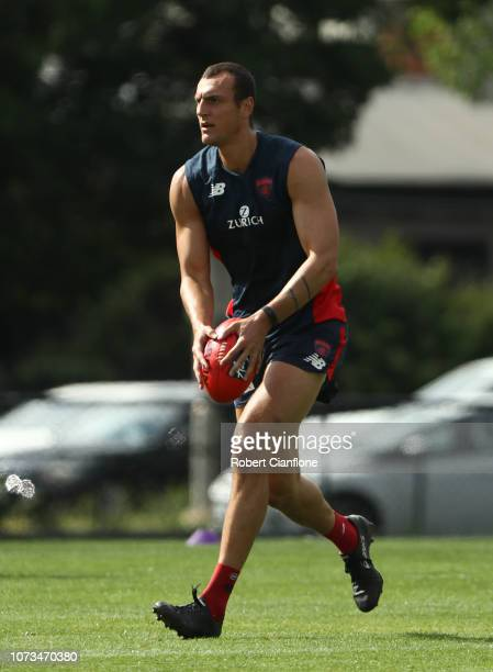 Braydon Preuss of the Demons runs with the ball during a Melbourne Demons AFL training session at Gosch's Paddock on November 28 2018 in Melbourne...