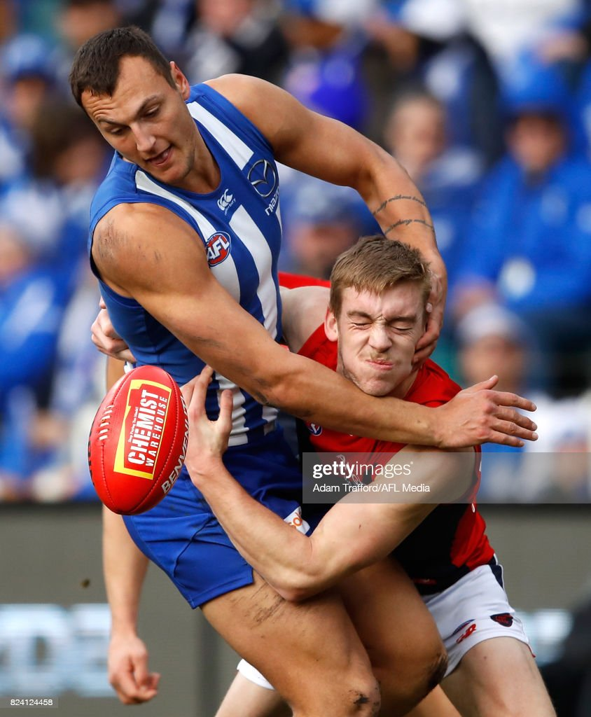 Braydon Preuss of the Kangaroos and Oscar McDonald of the Demons compete for the ball during the 2017 AFL round 19 match between the North Melbourne Kangaroos and the Melbourne Demons at Blundstone Arena on July 29, 2017 in Hobart, Australia.