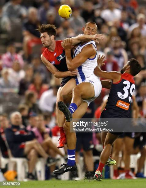 Braydon Preuss of the Kangaroos and Tomas Bugg of the Demons collide during the AFLX match between the North Melbourne Kangaroos and the Melbourne...