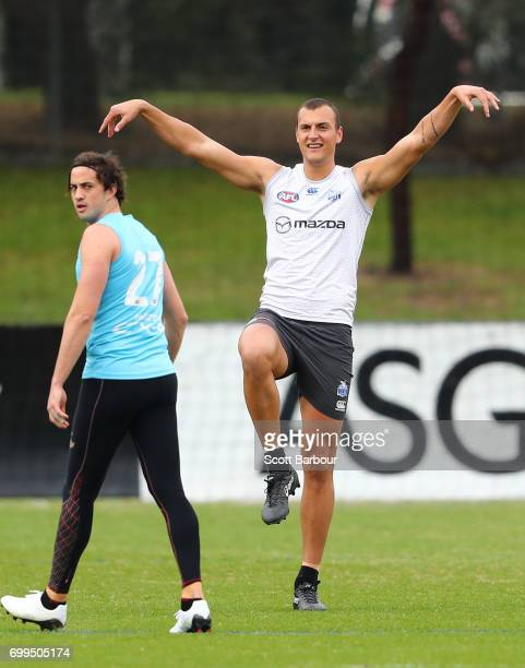 Braydon Preuss of the Kangaroos attempts to block a kick during a North Melbourne Kangaroos AFL training session at Arden Street Ground on June 22...