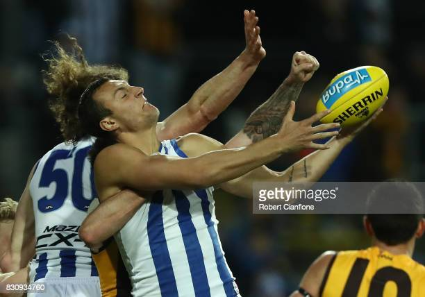 Braydon Preuss of the Kangaroos looks to get the ball during the round 21 AFL match between the Hawthorn Hawks and the North Melbourne Kangaroos at...