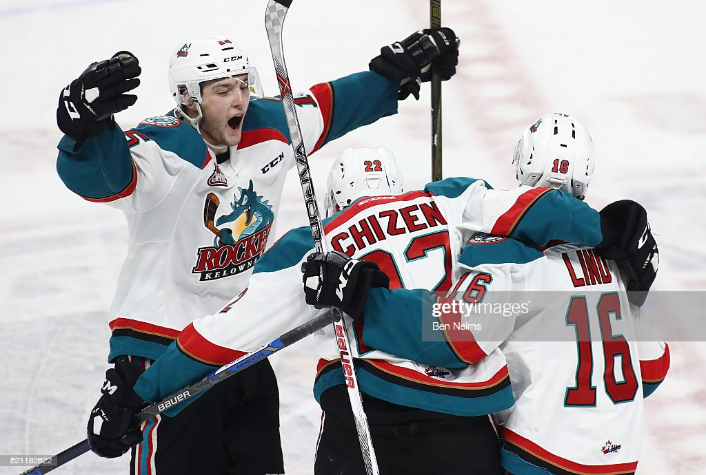 Braydyn Chizen #22 of the Kelowna Rockets celebrates his goal against the Vancouver Giants with teammates Tomas Soustal #15 and Kole Lind #16 during the second period of their WHL game at the Langley Events Centre on November 4, 2016 in Langley, British Columbia, Canada.