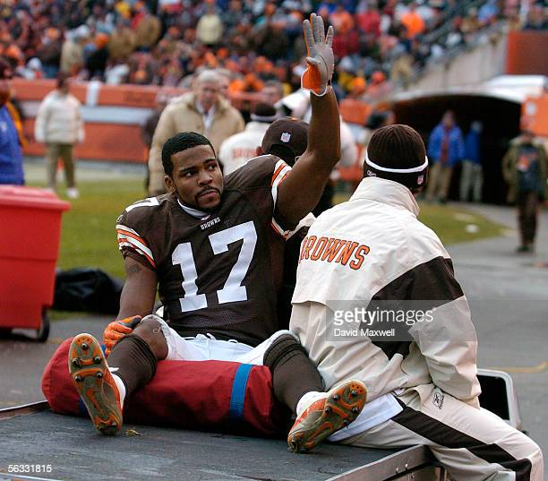 Braylon Edwards of the Cleveland Browns waves as he is carried out of the stadium on a cart after being injured during the fourth quarter against the...