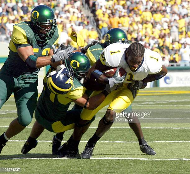 Braylon Edwards of the Michigan Wolverines has his helmet knoked off by the Oregon defense at Autzen Stadium in Eugene Oregon Oregon defeated...