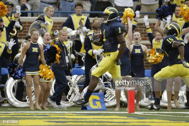 Braylon Edwards of the Michigan Wolverines scores a touchdown on a 58 yard pass against the Iowa Hawkeyes during the second quarter of the game at...