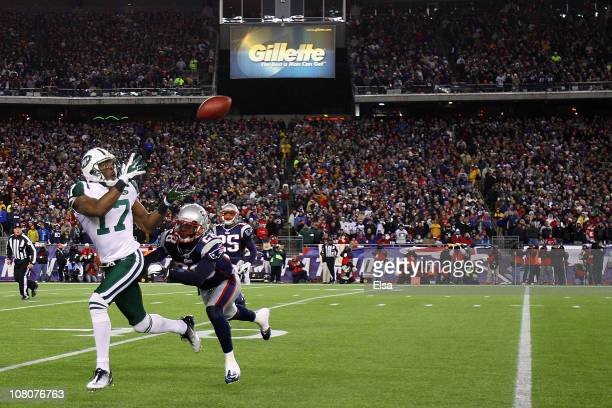 Braylon Edwards of the New York Jets catches a pass over Darius Butler of the New England Patriots during their 2011 AFC divisional playoff game at...