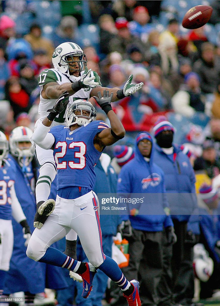 Braylon Edwards #17 of the New York Jets goes up for a pass against Aaron Williams #23 of the Buffalo Bills at Ralph Wilson Stadium on December 30, 2012 in Orchard Park, New York. Buffalo won 28-9.