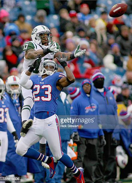 Braylon Edwards of the New York Jets goes up for a pass against Aaron Williams of the Buffalo Bills at Ralph Wilson Stadium on December 30, 2012 in...