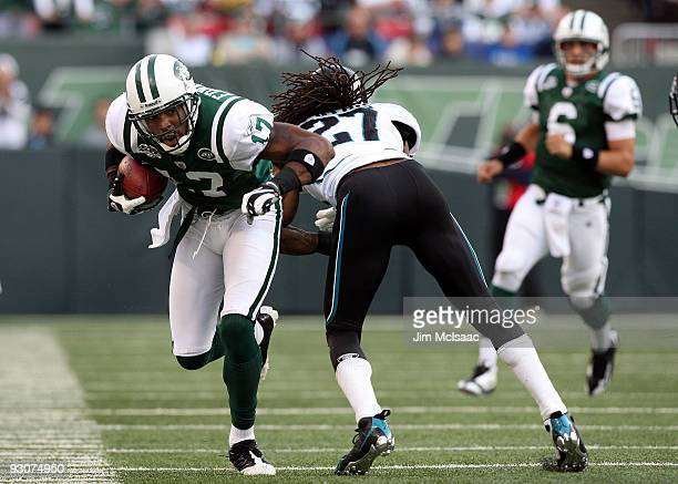 Braylon Edwards of the New York Jets runs the ball against Rashean Mathis of the Jacksonville Jaguars after a reception on November 15, 2009 at...