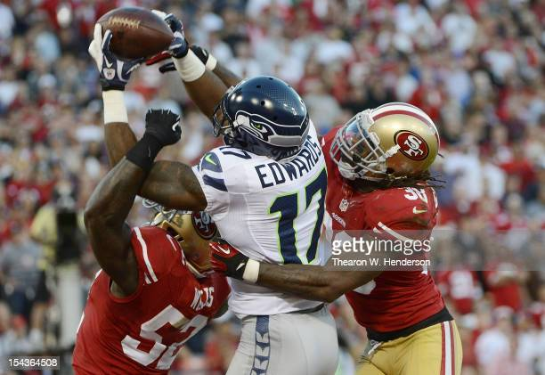 Braylon Edwards of the Seattle Seahawks has this pass broken up in the endzone by Patrick Willis and Dashon Goldson of San Francisco 49ers during the...