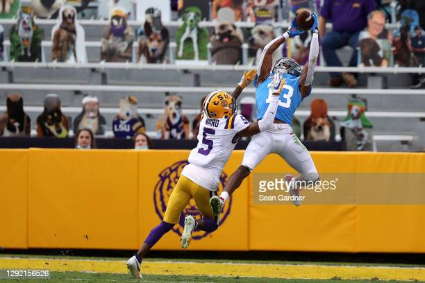 Braylon Sanders of the Mississippi Rebels scores a touchdown over Jay Ward of the LSU Tigers during a game at Tiger Stadium on December 19, 2020 in...
