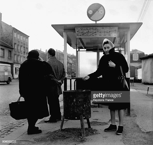 Brazier At A Bus Stop Due To The Cold In The Suburb Of Paris in SaintDenis France on January 18 1963