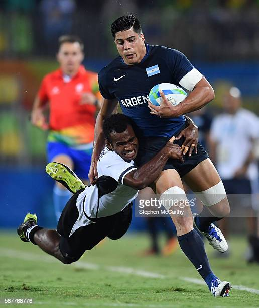 JANEIRO Brazil 9 August 2016 Axel Muller of Argentina is tackled by Jerry Tuwai of Fiji during the Men's Pool A Rugby Sevens match between Fiji and...