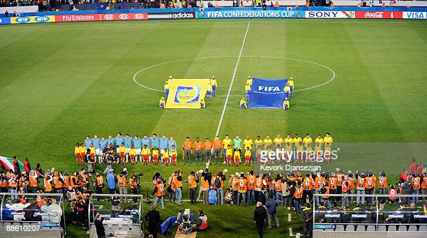 Brazil and Italy teams line up before their match against Italy during the FIFA Confederations Cup match between Italy and Brazil at the Loftus...