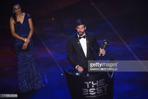 Brazil and Liverpool goalkeeper Alisson Becker speaks after winning the trophy for the Best FIFA Men's Goalkeeper of 2019 Award presented by Brazil...