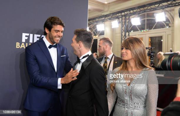 Brazil and Orlando City midfielder Kaka greets Lionel Messi of Argentina and his wife Antonella Roccuzzo while arriving for the FIFA Ballon d'Or Gala...