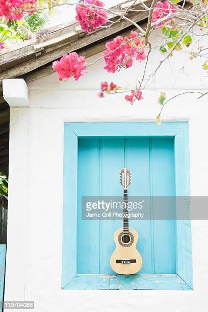Brazil, Bahia, Trancoso, Guitar against building wall
