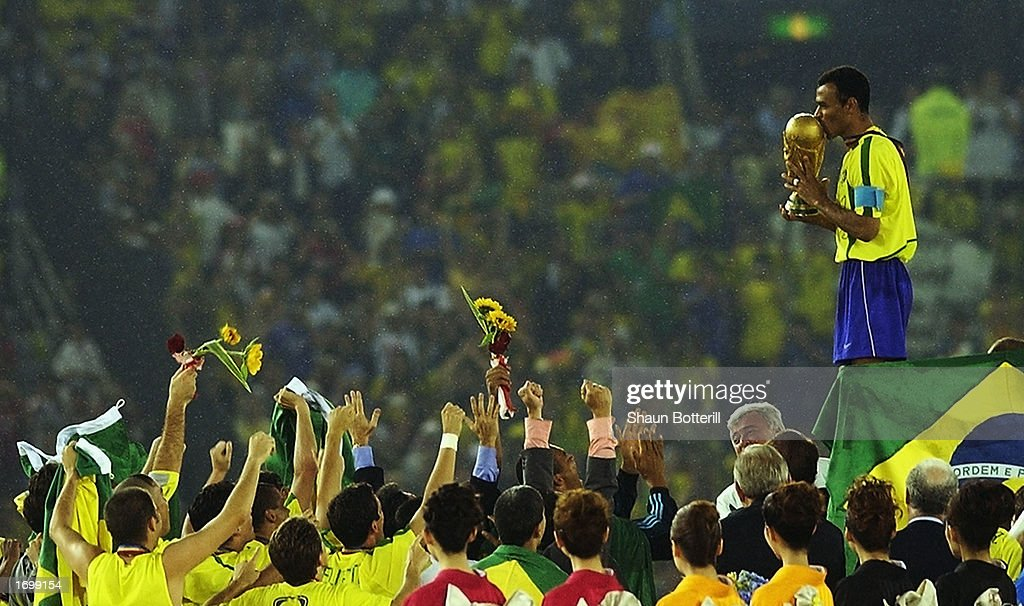 Brazil captain Cafu celebrates on the podium with the World Cup trophy after the World Cup Final match against Germany played at the International Stadium Yokohama, Yokohama, Japan on June 30, 2002. Brazil won the match 2-0.