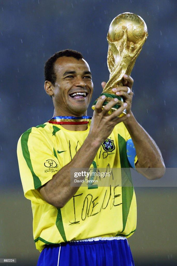 Brazil captain Cafu lifts the trophy after the Germany v Brazil, World Cup Final match played at the International Stadium Yokohama in Yokohama, Japan on June 30, 2002. Brazil won 2-0.