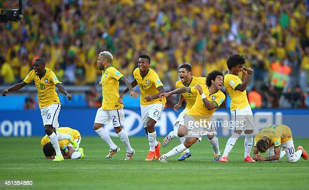 Brazil celebrate after defeating Chile in a penalty shootout during the 2014 FIFA World Cup Brazil round of 16 match between Brazil and Chile at...