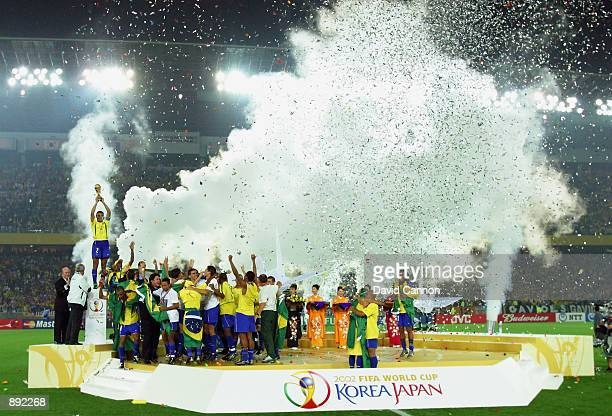 Brazil celebrate as captain Cafu lifts the trophy after the Germany v Brazil World Cup Final match played at the International Stadium Yokohama in...