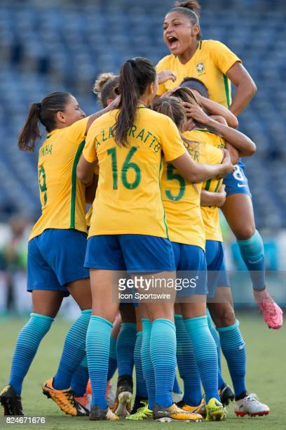Brazil celebrate taking the lead late in the game during the Tournament of Nations soccer match between USA and Brazil on July 30 2017 at Qualcomm...