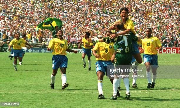 Brazil charge at hero Taffarel after they beat Italy in the penalty shoot out
