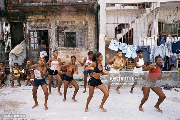 Brazil, children from youth project dancing in street
