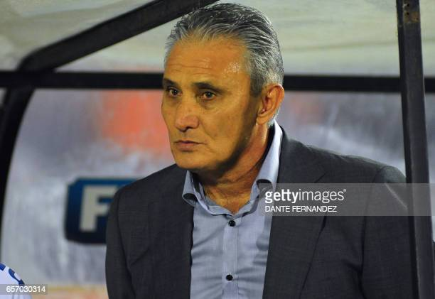Brazil coach Tite gestures ahead of their 2018 FIFA World Cup qualifier football match against Uruguay at the Centenario stadium in Montevideo on...