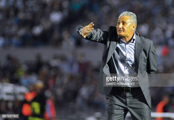 Brazil coach Tite gestures during their 2018 FIFA World Cup qualifier football match against Uruguay at the Centenario stadium in Montevideo on March...