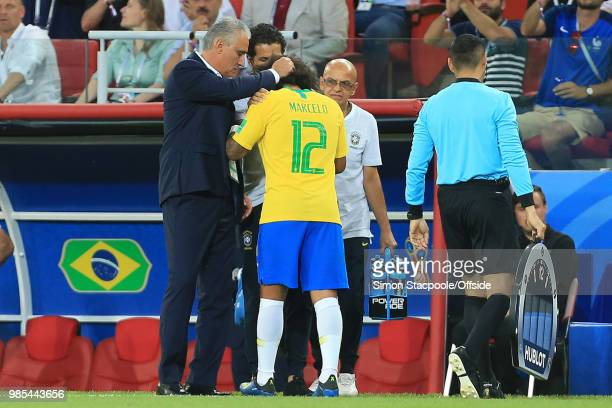 Brazil coach Tite talks with Marcelo of Brazil who had to leave the pitch with a suspected injury or illness during the 2018 FIFA World Cup Russia...