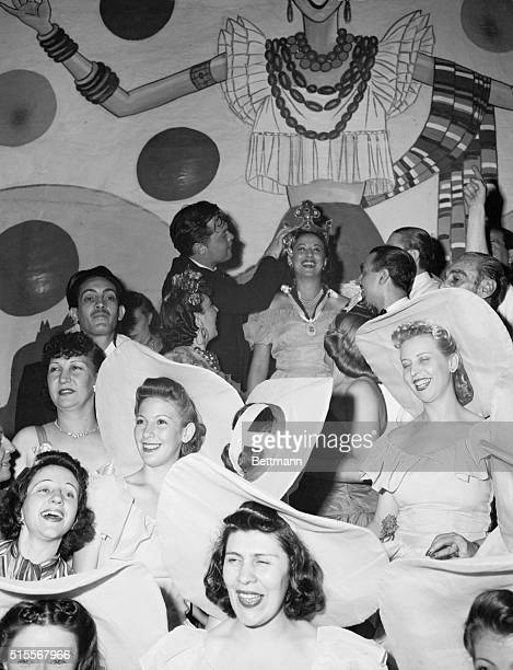 Coronation Surrounded by handmaidens in picture hats a Brazilian Miss has a thrilling moment as she is crowned Queen of the Beaux Arts Ball by Orson...