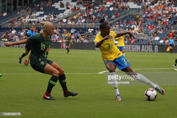 Brazil defender Daiane tries to get the ball outside Australia midfielder Tameka Butt in the first half of a women's soccer match between Brazil and...