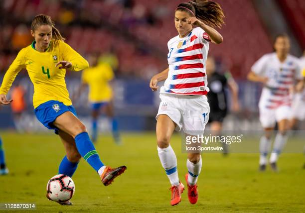 Brazil defender Erika protects the ball from Unites States forward Alex Morgan during the She Believes Cup match between the USA and Brazil on March...