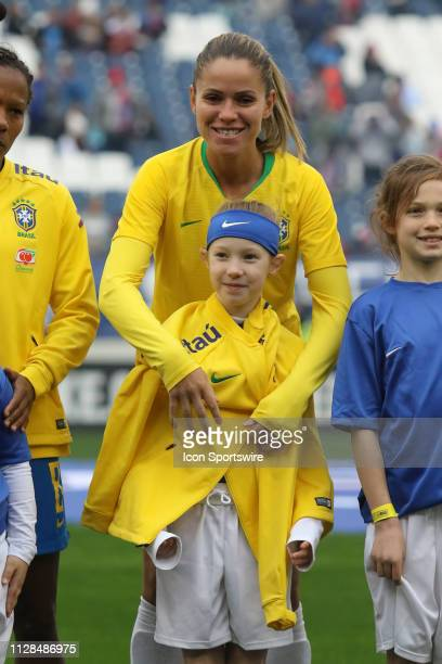 Brazil defender Erika shares her jacket with the ball girl before the She Believes Cup match between Brazil and Japan at Nissan Stadium on March 2nd...