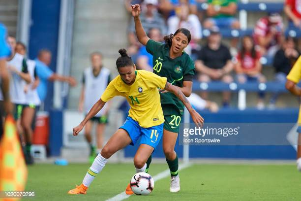 Brazil defender Poliana battles with Australia forward Sam Kerr for the ball in game action during a Tournament of Nations match between Brazil vs...