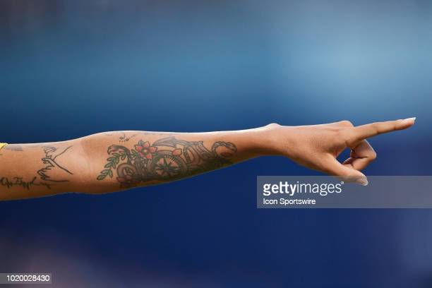 Brazil defender Poliana points down field as a detailed view of her tattoos are seen on her arm is seen in game action during a Tournament of Nations...