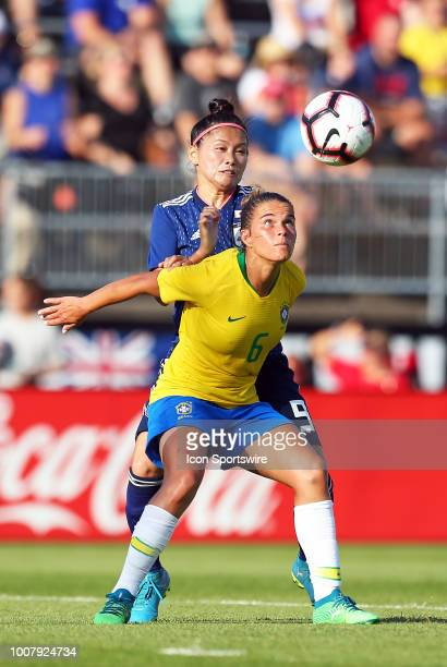 Brazil defender Tamires and Japan forward Nahomi Kawasumi in action during a friendly match between Japan and Brazil on July 29 at Pratt Whitney...