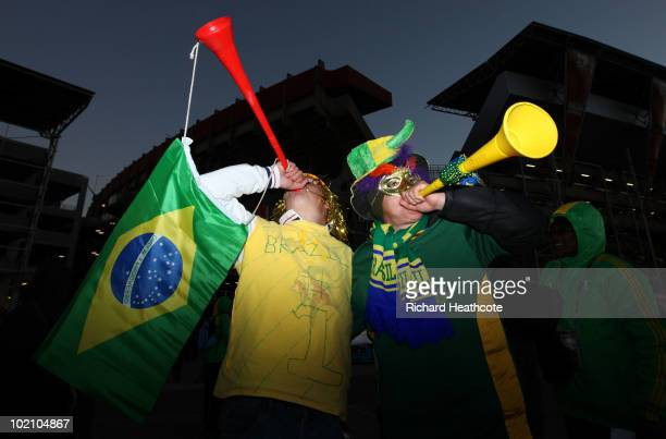 Brazil fan blow vuvuzelas as they enjoy the atmosphere ahead of the 2010 FIFA World Cup South Africa Group G match between Brazil and North Korea at...