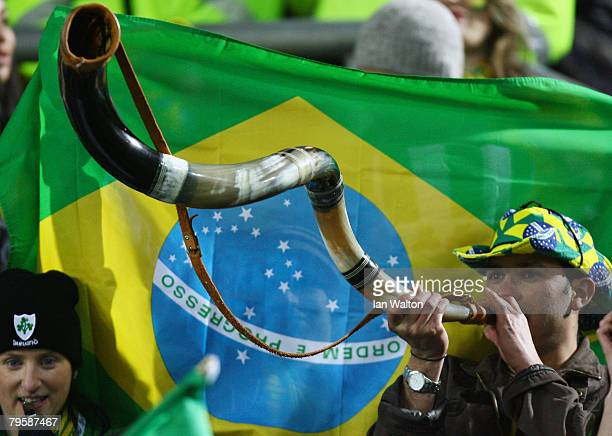 Brazil fan blows a horn during the International Friendly match between Republic of Ireland and Brazil at Croke Park on February 6 2008 in Dublin...